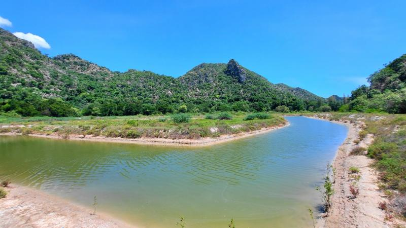 48 Rai of development land for sale in Sam Roi Yot – Fully surrounded with mountains and 1.5 km to beach!